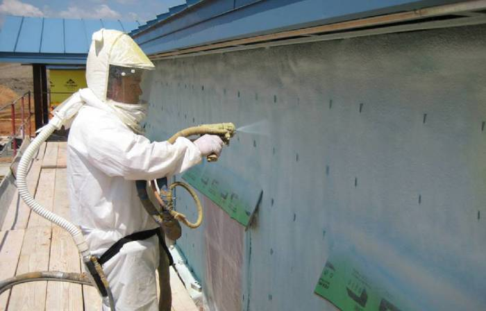 Man spraying coating